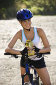 Young woman biking. — Stock Photo