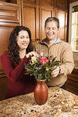 Couple arranging flowers. — Stock Photo