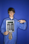 Boy holding huge calculator. — Foto de Stock
