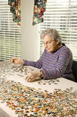 Elderly Woman Doing Jig Saw Puzzle — Stock Photo