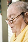 Mature man wearing eyeglasses. — Stock Photo