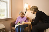 Woman Visiting Older Woman — Stock Photo
