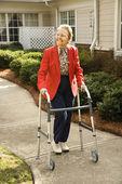 Elderly Woman Using Walker — Stock Photo