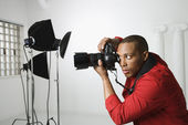Man photographing in studio. — Stock Photo