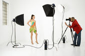Young female model being photographed by male photographer. — Stock Photo