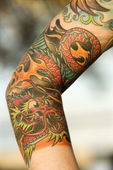 Tattooed arm. — Stock Photo