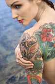 Nude tattooed woman. — Stock Photo