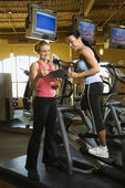 Woman with fitness trainer. — Stock Photo