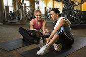 Woman with trainer at gym. — Stock Photo