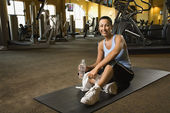 Woman at fitness gym. — Stock Photo