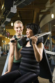Woman at gym with trainer. — Stock Photo