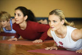 Adult females in yoga class. — Stock Photo