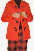 Woman buttoning coat. — Stock Photo