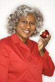 Woman eating apple. — Stock Photo