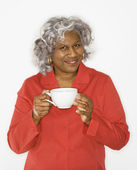 Woman holding coffee cup. — Stock Photo