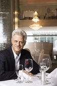 Mature man in restaurant. — Stock Photo