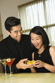 Attractive Young Man Giving Gift to Woman — Stock Photo
