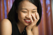 Happy laughing Asian woman. — Stock Photo