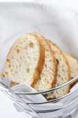 Sliced Bread in Wire Basket — Stock Photo