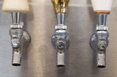 Trio of Beer Tap Spouts — Stock Photo