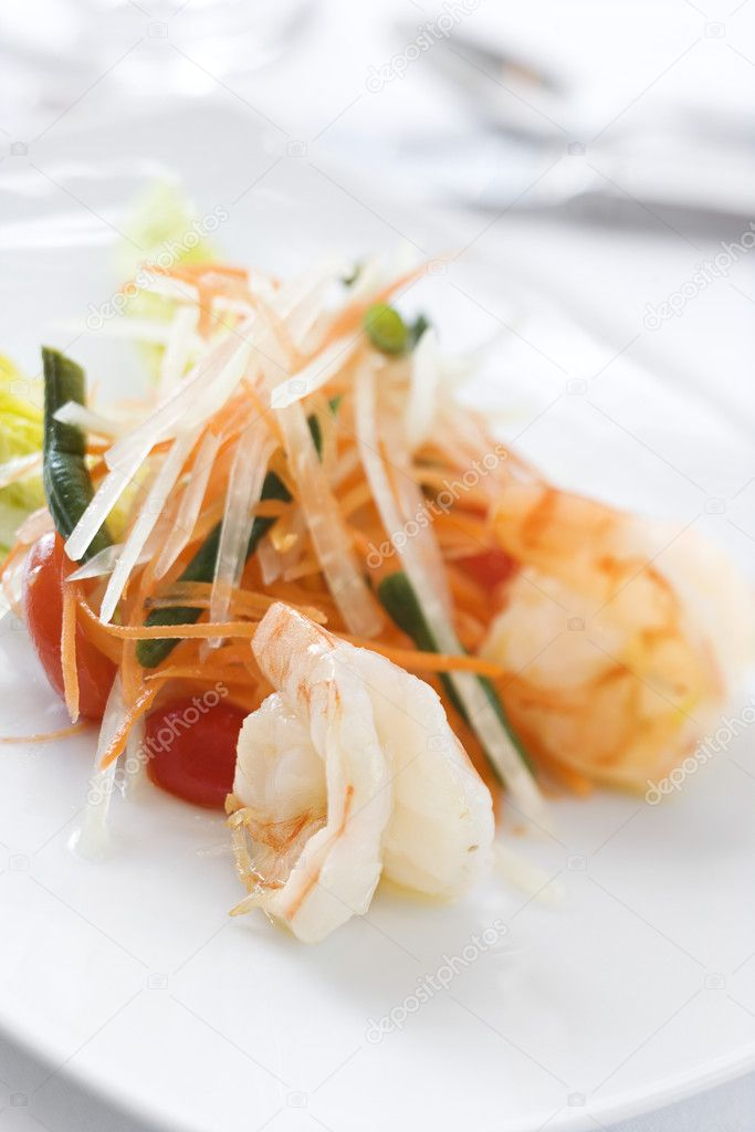 Gourmet seafood dish elegantly displayed on a white dish in an upscale restaurant. Vertical shot. — Stock Photo #9367722