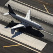 Airplane on runway. - Stock Photo