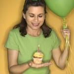 Woman holding birthday cupcake. — Stock Photo