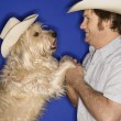 Stock Photo: Dog and man in cowboy hats.