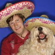Dog and man wearing sombreros. — Stock Photo #9425623