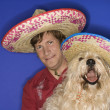 Dog and man wearing sombreros. — Stock Photo #9425624