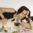 Royalty-Free Stock Photo: Woman with two Pug dogs.