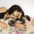 Woman with two Pug dogs. — 图库照片