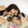 Woman with two Pug dogs. — Stockfoto