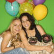 Stock Photo: Women with small dogs and balloons.