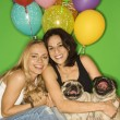 Royalty-Free Stock Photo: Women with small dogs and balloons.