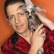 Man holding Chinese Crested dog. — Stock Photo