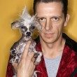 Mholding Chinese Crested dog. — Stock Photo #9426130
