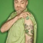 Caucasian man showing tattoo. — Stock Photo