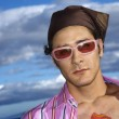 Young Man With Sunglasses and Headscarf — Stock Photo #9428925