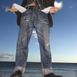 Young Man at Beach with Empty Pockets — Stock Photo