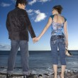 Foto Stock: Couple Holding Hands on Beach