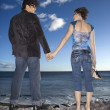 Couple Holding Hands on Beach - Stock Photo