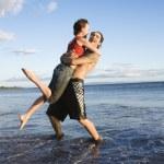 Romantic couple on beach. — Stock Photo
