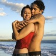 Foto Stock: Couple embracing on beach.
