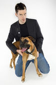 Man with Boxer dog. — Stock Photo