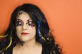 Woman wearing unique makeup. — Stock Photo