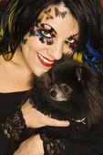 Woman holding Pomeranian dog. — Stock Photo