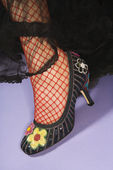 Shoe with fishnet stocking. — Stock Photo