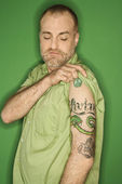 Caucasian man showing tattoo. — Stock Photo