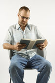 Man reading book. — Stock Photo